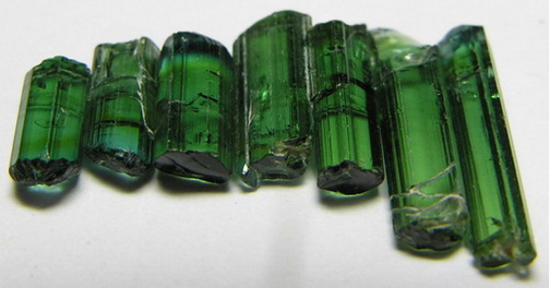 seven20green20tourmaline20crystals20in20a20row